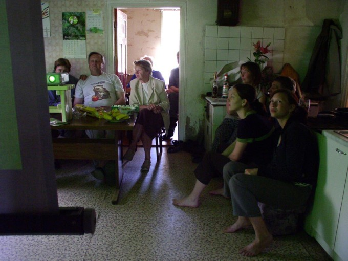 The kitchen of Latvian participants Martins and Zaiga Treimani: family and workers gather to watch and comment on Martins route.